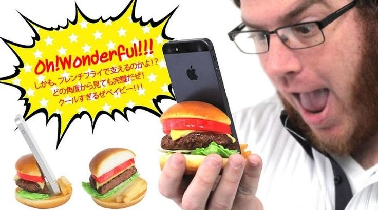 Image showing man using a hamburger shaped phone stand