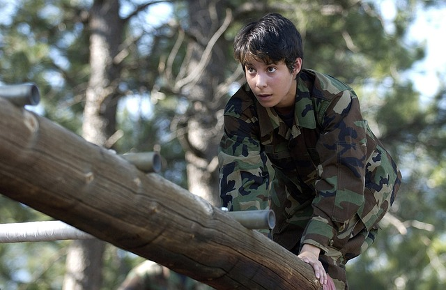 Image showing a female soldier in an obstacle course. It denotes the fact that extra effort pays off.