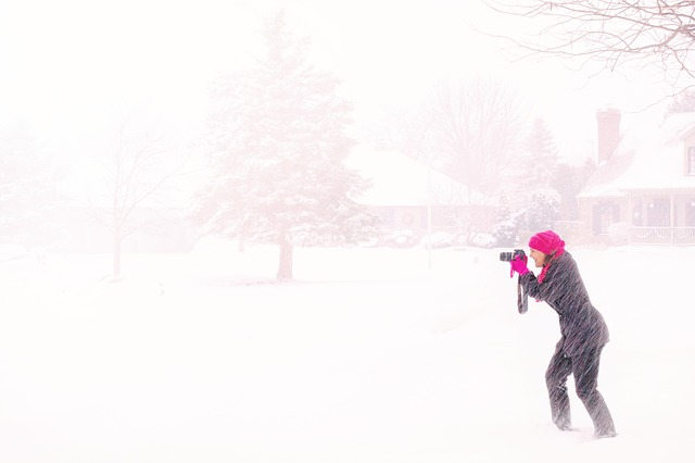 Image of Woman photographer in a snow storm